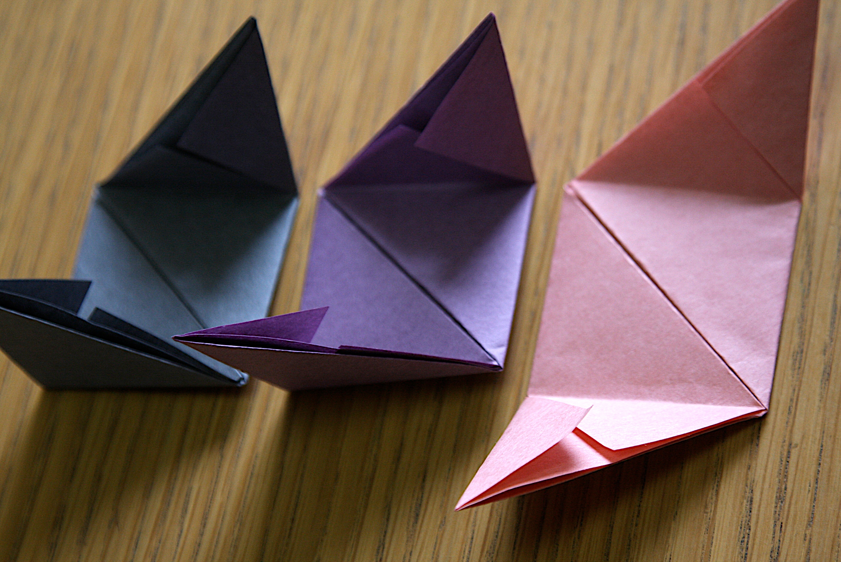 Take Two Pieces And Insert A Triangle From One Paper Into The Opening On Square Of Another
